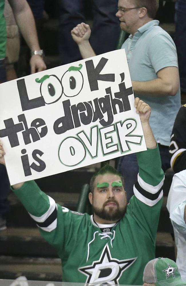 A Dallas Stars fan holds up a sign after an NHL hockey game between the St. Louis Blues and the Dallas Stars on Friday, April 11, 2014, in Dallas. The Stars won 3-0