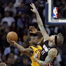 Cleveland Cavaliers' Dion Waiters goes in for a shot against Miami Heat's Chris Andersen (11) in the fourth quarter of an NBA basketball game Wednesday, Nov. 27, 2013, in Cleveland. Waiters scored 24 points off the bench in a 95-84 loss to the Heat The As