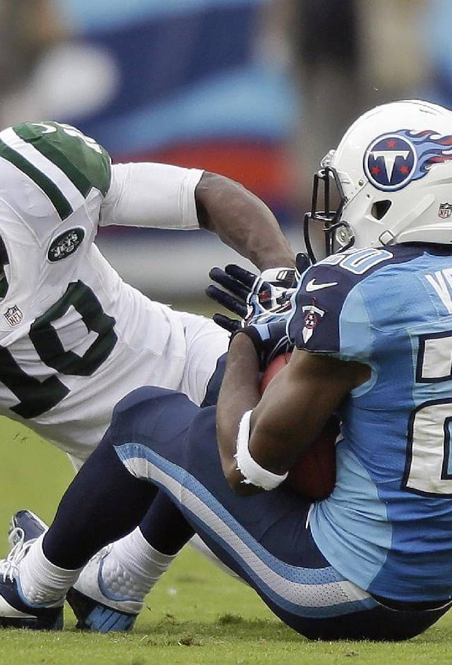 In this Sept 29, 2013, file photo, Tennessee Titans cornerback Alterraun Verner (20) intercepts a pass intended for New York Jets wide receiver Santonio Holmes (10) during the second quarter of an NFL football game in Nashville, Tenn. The Kansas City Chiefs and the Titans are tied for the most takeaways in the NFL. Well, actually Titans safety Michael Griffin says it's mostly cornerback Alterraun Verner, who leads the league with six takeaways all by himself
