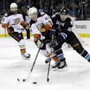 San Jose Sharks' Patrick Marleau (12) and Anaheim Ducks' Sami Vatanen (45) reach for the puck during the third period of an NHL hockey game Thursday, Jan. 29, 2015, in San Jose, Calif The Associated Press