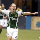 File-In this May 12, 2013 file photo shows Portland Timbers midfielder Will Johnson celebrating after scoring a goal in penalty time at an MLS soccer game against Chivas USA in Portland, Ore. Less than 12 hours after a game, Johnson, the Timbers captain, is pulling weeds in a public park. He has led the Timbers' resurgence this season in soccer-crazy Portland and is also taking part in his team's week of community service, and yanking a few weeds for a good cause. (AP Photo/Don Ryan, File)