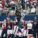 Dallas Cowboys wide receiver Dez Bryant (88) pulls in a catch for a first down against Houston Texans cornerback Johnathan Joseph (24) during the second half of an NFL football game, Sunday, Oct. 5, 2014 in Arlington, Texas The Associated Press
