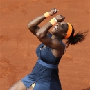 Serena Williams, of the U.S, celebrates as she defeats Russia's Maria Sharapova during the Women's final match of the French Open tennis tournament at the Roland Garros stadium Saturday, June 8, 2013 in Paris. Williams won 6-4, 6-4. (AP Photo/David Vincent)
