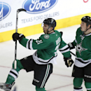 Dallas Stars left wing Antoine Roussel (21), of France, and center Cody Eakin (20) celebrate Roussel's game tying goal during the third period of an NHL hockey game against the Anaheim Ducks Friday, Oct. 31, 2014, in Dallas The Associated Press