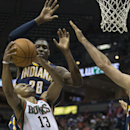Milwaukee Bucks' Roman Sessions (13) is fouled by Indiana Pacers' Ian Mahinmi (28) during the first half of an NBA basketball game on Wednesday, April 9, 2014, in Milwaukee The Associated Press