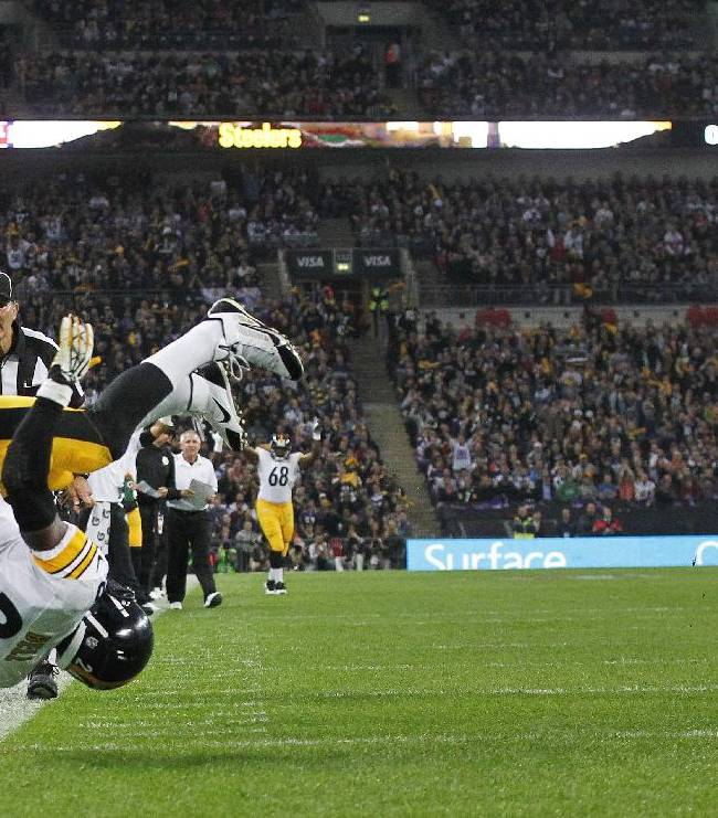 Pittsburgh Steelers running back Le'Veon Bell flips over as he scores a touchdown during the  NFL football game against Minnesota Vikings at Wembley Stadium, London, Sunday, Sept. 29, 2013.  It was Bell's first touchdown as a pro