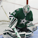 The puck slips past Dallas Stars goalie Kari Lehtonen (32) scoring the winning goal during overtime of an NHL hockey game against the Philadelphia Flyers Saturday, Oct. 18, 2014, in Dallas. The Flyers won 6-5 The Associated Press