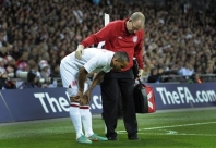 Walcott undergoes scans on chest injury