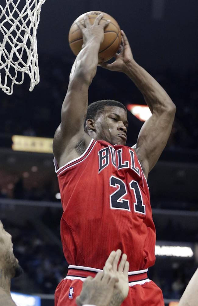 Chicago Bulls' Jimmy Butler gets a defensive rebound in the second half of an NBA basketball game against the Memphis Grizzlies in Memphis, Tenn., Monday, Dec. 30, 2013. The Bulls defeated the Grizzlies 95-91