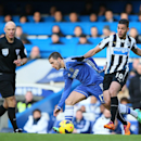 Chelsea's Eden Hazard, left, pushed off the ball by Newcastle's Hatem Ben Arfa during their English Premier League soccer match between Chelsea and Newcastle United in London, Saturday, Feb. 8, 2014