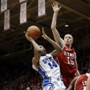Duke's Rasheed Sulaimon (14) drives to the basket against North Carolina State's Scott Wood (15) during the first half of an NCAA college basketball game in Durham, N.C., Thursday, Feb. 7, 2013. (AP Photo/Gerry Broome)