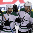 Dallas Stars center Travis Morin (39) Patrick Eaves (18) after Eaves score against the Florida Panthers in the first period of an NHL hockey preseason game, in Sunrise, Fla., Wednesday, Sept. 24, 2014. The Associated Press