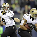 New Orleans Saints quarterback Drew Brees hands off to Pierre Thomas in the first half of an NFL football game against the Seattle Seahawks, Monday, Dec. 2, 2013, in Seattle The Associated Press
