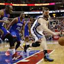 Memphis Grizzlies' Marc Gasol, right, of Spain, chases down a loose ball as Philadelphia 76ers' James Anderson, left, and Thaddeus Young look on during the first half of an NBA basketball game, Saturday, March 15, 2014, in Philadelphia. (AP Photo/Matt Slocum)