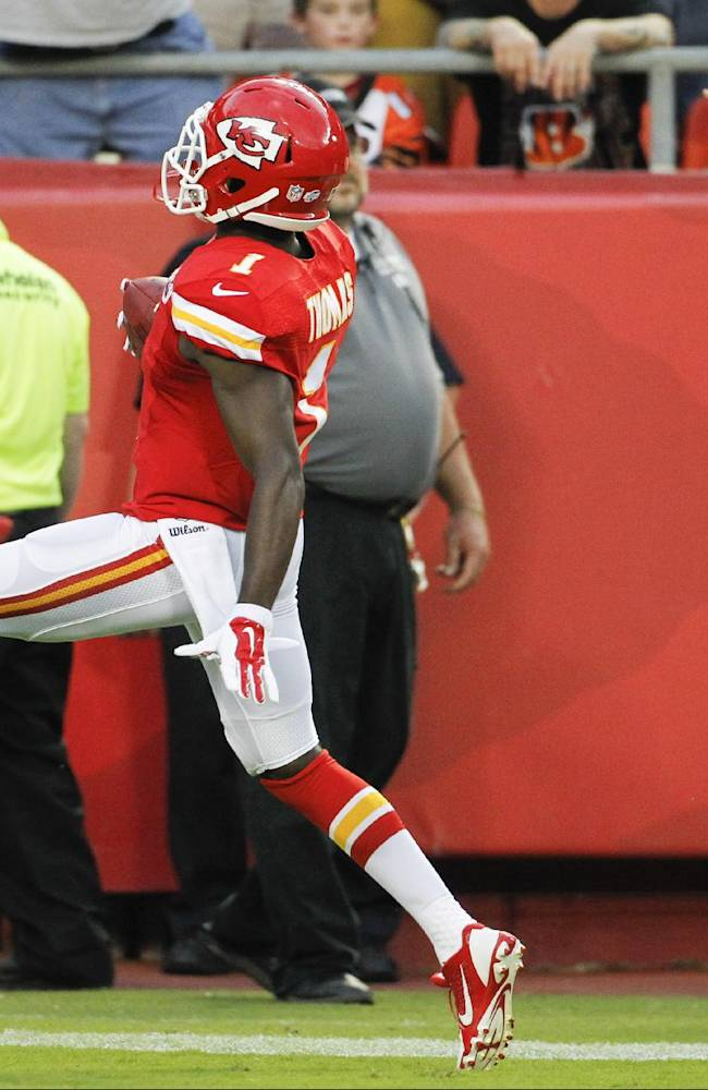 Kansas City Chiefs' De'Anthony Thomas runs to the end zone for touchdown on a kickoff return in the first half of an NFL preseason football game against the Cincinnati Bengals on Thursday, Aug. 7, 2014, in Kansas City, Mo