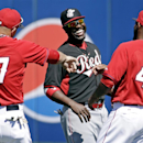 Los Angeles Angels' Mike Trout (27) and Howie Kendrick (47) have some fun with Cincinnati Reds' Brandon Phillips before an exhibition spring training baseball game Sunday, March 9, 2014, in Tempe, Ariz The Associated Press