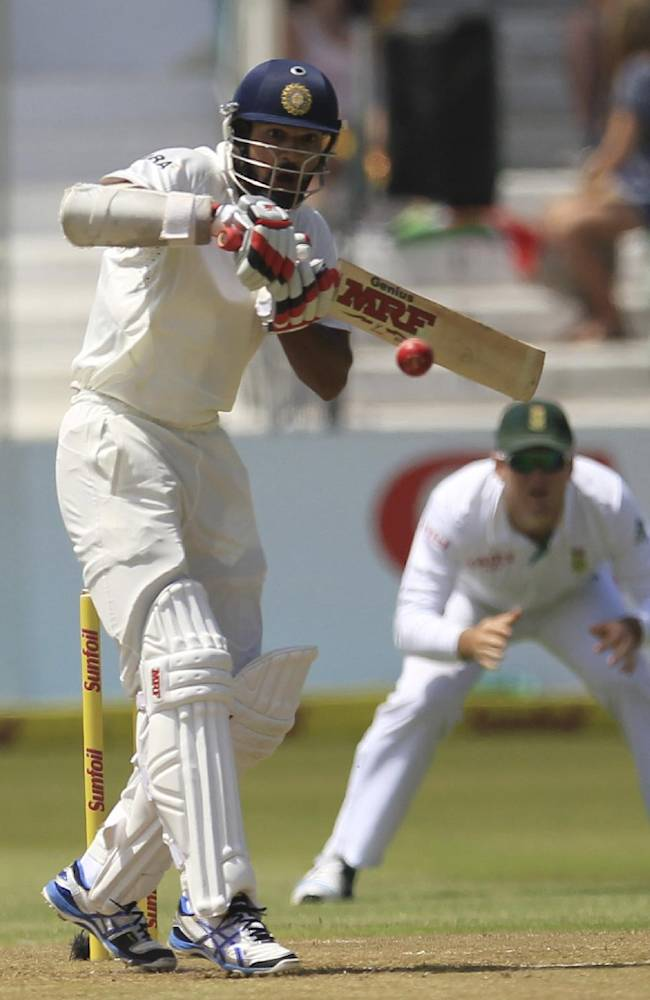 India's batsman Shikhar Dhawan plays a shot during first day of their cricket test match against South Africa at Kingsmead stadium, Durban, South Africa, Thursday, Dec. 26, 2013. AP Photo/ Themba Hadebe)