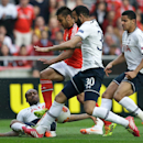 Benfica's Salvio, second left, fights for the ball with Tottenham Hotspur's Danny Rose, second right, during their Europa League round of 16, second leg, soccer match Thursday, March 20 2014, at Benfica's Luz stadium