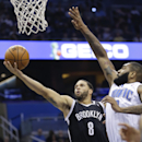 Orlando Magic's Kyle O'Quinn, right, blocks a shot attempt by Brooklyn Nets' Deron Williams (8) during the first half of an NBA basketball game in Orlando, Fla., Wednesday, April 9, 2014 The Associated Press