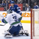 Toronto Maple Leafs forward Joffrey Lupul (19) watches as the puck goes past Vancouver Canucks goalie Ryan Miller (30) during second period NHL hockey action in Toronto on Saturday, Dec. 6, 2014 The Associated Press