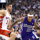 Sacramento Kings' Isaiah Thomas, right, drives past Toronto Raptors' Greivis Vasquez during first half NBA basketball action in Toronto on Friday March 7, 2014 The Associated Press