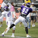Minnesota Vikings free safety Kurt Coleman, left, breaks up a pass intended for tight end Kyle Rudolph during an NFL football training camp practice, Wednesday, July 30, 2014, in Mankato, Minn The Associated Press