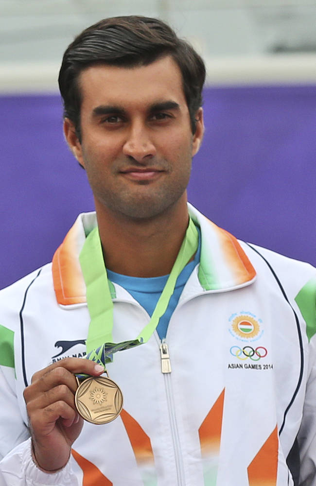 India's Yuki Bhambri poses for a photo after the men's tennis final at the 17th Asian Games in Incheon, South Korea,  Tuesday, Sept. 30, 2014