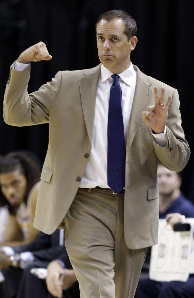 Indiana Pacers head coach Frank Vogel calls a play for his team in the first half of an NBA preseason basketball game against the Chicago Bulls in Indianapolis, Saturday, Oct. 5, 2013