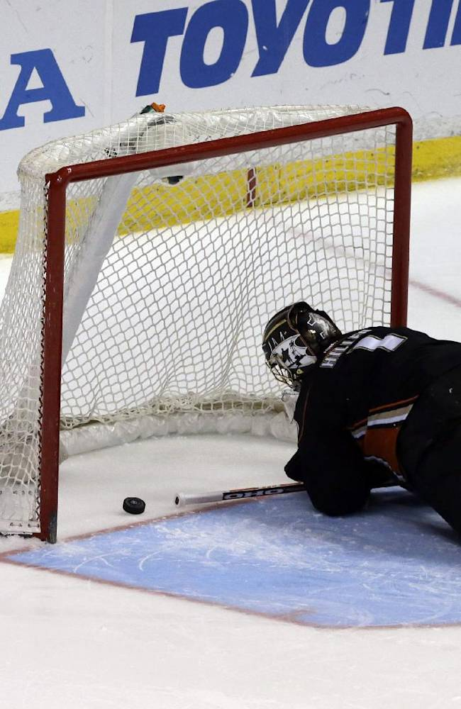 Anaheim Ducks goalie Jonas Hiller (1), of Switzerland, reacts after Pittsburgh Penguins left winger Chris Kunitz, not shown, in a shootout in an NHL hockey game in Anaheim, Calif., Friday, March 7, 2014.  The Penguins won the shootout, 3-2
