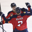 Florida Panthers players Nick Bjugstad (27) and Dmitry Kulikov (7) celebrate after Kulikov scored a goal against the Buffalo Sabres during the third period of an NHL hockey game in Sunrise, Fla., Friday, March 7, 2014. The Panthers won 2-0 The Associated