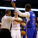 Referee Michael Smith (38) separates Phoenix Suns guard Goran Dragic (1), of Slovenia, and Los Angeles Clippers guard Chris Paul (3) during the first half of an NBA basketball game, Wednesday, April 2, 2014, in Phoenix. Paul was called for a technical fou