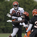 Cincinnati Bengals wide receiver A.J. Green (18) catches a pass against cornerback Dre Kirkpatrick during the NFL football team's practice at training camp, Friday, July 25, 2014, in Cincinnati. (AP Photo) The Associated Press