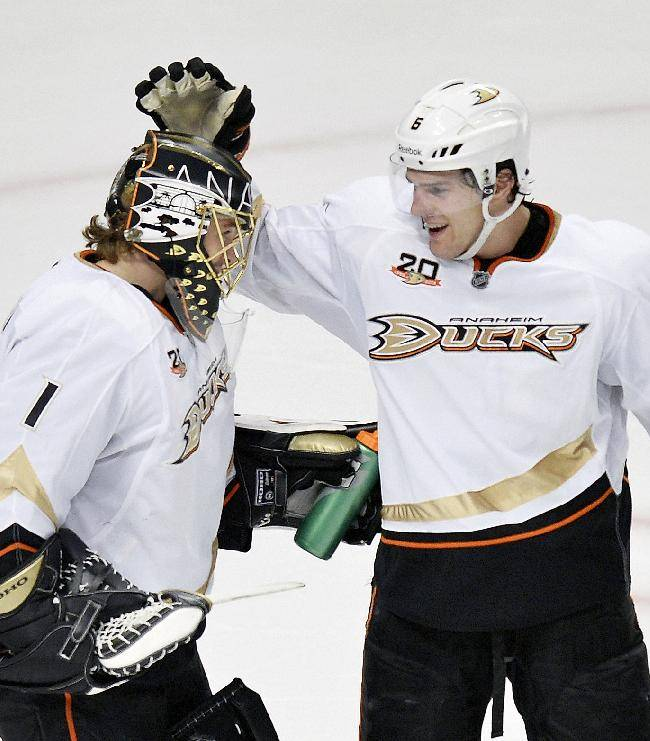 Anaheim Ducks goalie Jonas Hiller, left, and defenseman Ben Lovejoy (6) celebrate the team's win over the Chicago Blackhawks after an NHL hockey game Friday, Dec. 6, 2013, in Chicago. The Ducks won 3-2 in a shootout