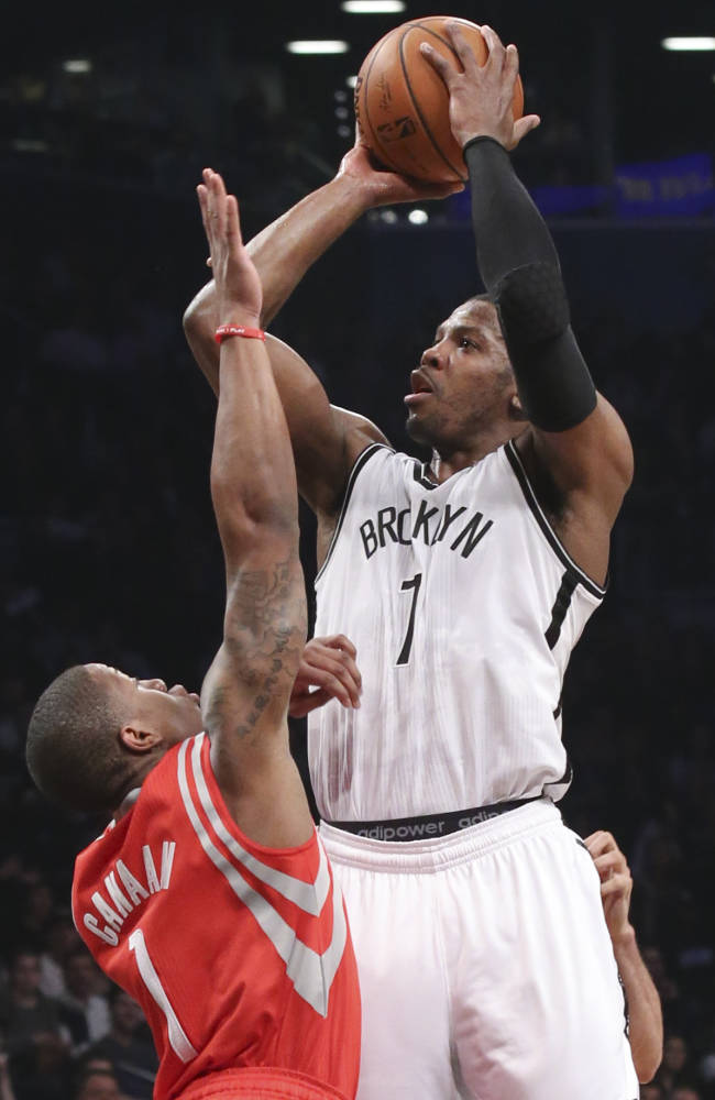 Brooklyn Nets guard Joe Johnson (7) shoots over Houston Rockets guard Isaiah Canaan (1) during the first half of their NBA basketball game at the Barclays Center, Tuesday, April 1, 2014, in New York