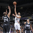 SACRAMENTO, CA - FEBRUARY 27: Tony Parker #9 of the San Antonio Spurs shoots against Carl Landry #24 of the Sacramento Kings on February 27, 2015 at Sleep Train Arena in Sacramento, California. (Photo by Rocky Widner/NBAE via Getty Images)