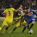Shrewsbury's Bobby Grant, right, controls the ball from Chelsea's Nathan Ake, center, and Chelsea's Filipe Luis during the fourth round of the English League Cup soccer match between Shrewsbury Town and Chelsea at Greenhous Meadow, Shrewsbury, England, Tu