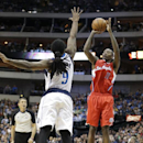 Los Angeles Clippers guard Jamal Crawford (11) shoots against Dallas Mavericks forward Jae Crowder (9) during the first half of an NBA basketball game Thursday, March 27, 2014, in Dallas The Associated Press