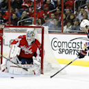 Washington Capitals defenseman Karl Alzner, left, works to clear the puck from in front of goalie Braden Holtby, center, as Columbus Blue Jackets center Artem Anisimov (42), of Russia, attacks, in the second period of an NHL hockey game Tuesday, Nov. 12,