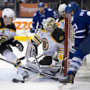 Toronto Maple Leafs left winger James van Riemsdyk, right, wraps a shot around on Boston Bruins goaltender Chad Johnson as defenseman Torey Krug (47) defends during the second period of an NHL game in Toronto on Thursday, April 3, 2014 The Associated Pres