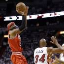 Chicago Bulls' Richard Hamilton, left, shoots over Miami Heat's Ray Allen (34) during the second half of Game 5 of an NBA basketball Eastern Conference semifinal, Wednesday, May 15, 2013, in Miami. (AP Photo/Wilfredo Lee)