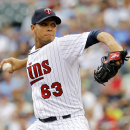 Fuld's 2-run single lifts Twins over White Sox 4-3 The Associated Press