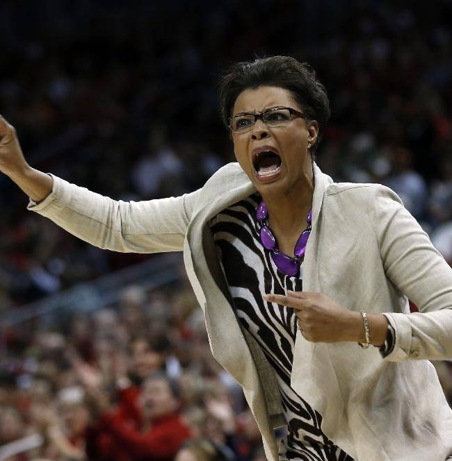 LSU head coach Nikki Caldwell directs her players from the bench during the first half of a regional semifinal game against Louisville at the NCAA college basketball tournament on Sunday, March 30, 2014, in Louisville, Ky