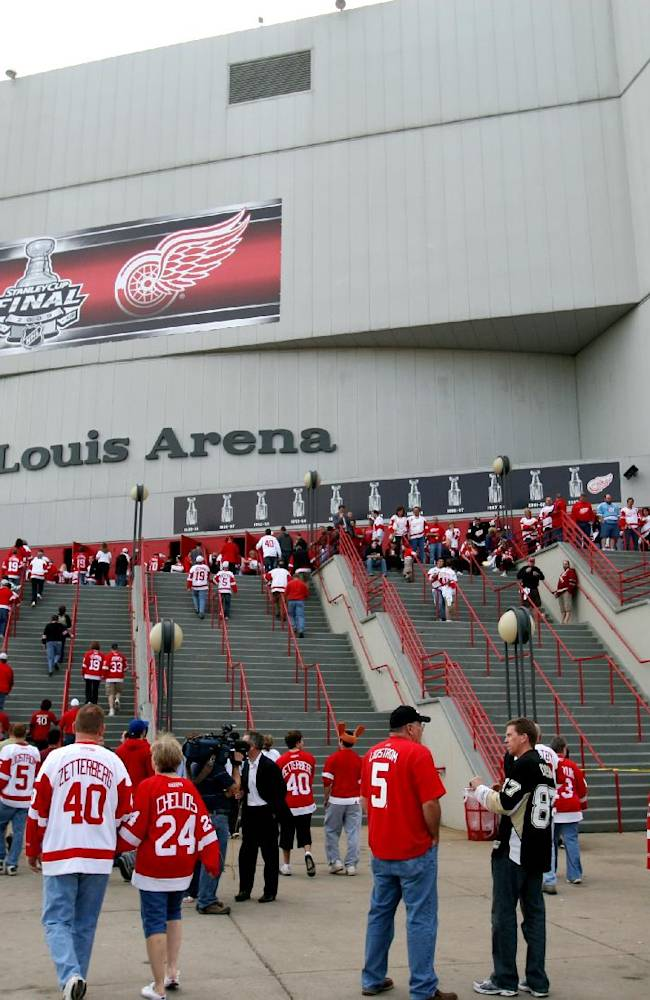 ADVANCE FOR SATURDAY, MARCH 1 - FILE- In this May 31, 2009, file photo fans enter Joe Louis Arena for Game 2 of the NHL Stanley Cup finals hockey series in Detroit. Repealing Michigan's rarely enforced ban against scalping tickets is, on its face, an effort to help out the average customer looking to sell a few unused tickets to a game or concert. But it's also a high-stakes financial tussle _ one between venue owners such as pro sports teams and public universities and brokers who buy and resell their tickets, mostly on the Internet