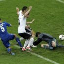 Germany's Miroslav Klose, second left, and Andre Schuerrle score a disallowed goal past Greece goalkeeper Michalis Sifakis, right, during the Euro 2012 soccer championship quarterfinal match between Germany and Greece in Gdansk, Poland, Friday, June 22, 2012. (AP Photo/Gero Breloer)