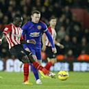 Southampton's Victor Wanyama, left, is challenged for the ball by Manchester United's Wayne Rooney during their English Premier League soccer match between Southampton and Manchester United at St Mary's stadium in Southampton, England, Monday, Dec. 8, 201