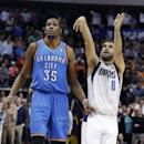 Dallas Mavericks guard Jose Calderon (8) of Spain, watches his 3-point shot go in, next to Oklahoma City Thunder forward Kevin Durant (35) during the fourth quarter of an NBA basketball game Tuesday, March 25, 2014, in Dallas. The Mavericks won 128-119 in