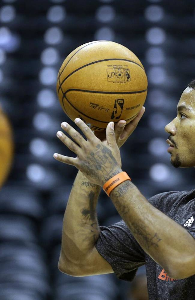 Chicago Bulls guard Derrick Rose shoots a one-handed free throw before an NBA preseason basketball game against the Indiana Pacers in Indianapolis, Saturday, Oct. 5, 2013