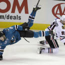 San Jose Sharks right wing Melker Karlsson (68) goes tumbling after the puck next to Chicago Blackhawks center Brad Richards (91) during the second period of an NHL hockey game Saturday, Jan. 31, 2015, in San Jose, Calif. (AP Photo/Eric Risberg)