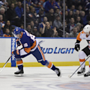 New York Islanders left wing Nikolay Kulemin (86) drives the puck past Philadelphia Flyers right wing Matt Read (24) to score in the second period of an NHL hockey game Monday, Jan. 19, 2015, in Uniondale, N.Y. Kulemin scored two goals during the Islander