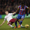Crystal Palace's Wilfried Zaha, right, competes for the ball with Aston Villa's Tom Cleverley during the English Premier League soccer match between Crystal Palace and Aston Villa at Selhurst Park stadium in London, Tuesday, Dec. 2, 2014